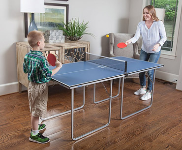 mom and son enjoying playing on thw Joola Midsize table