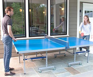 man and woman enjoying playing on the Joola NOVA Outside table