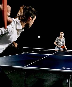 man and woman enjoying playing on the MD Sports ping pong table